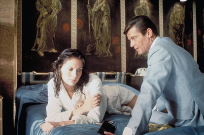 """Actor Roger Moore and actress Maud Adams on the set of """"The Man With The Golden Gun"""". (Photo by Suns..."""