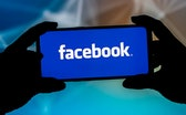 POLAND - 2021/09/23: In this photo illustration a Facebook logo seen displayed on a smartphone. (Pho...