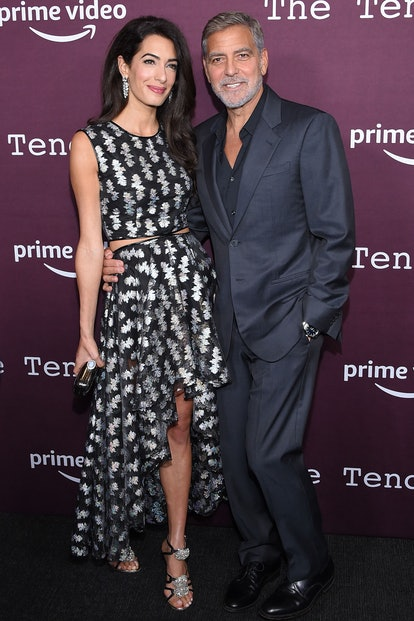 """Lebanese-British barrister Amal Clooney (L) and husband US actor George Clooney arrive for """"The Tend..."""