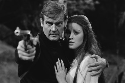 English actors Roger Moore and Jane Seymour as superspy James Bond and tarot reader Solitaire in the...