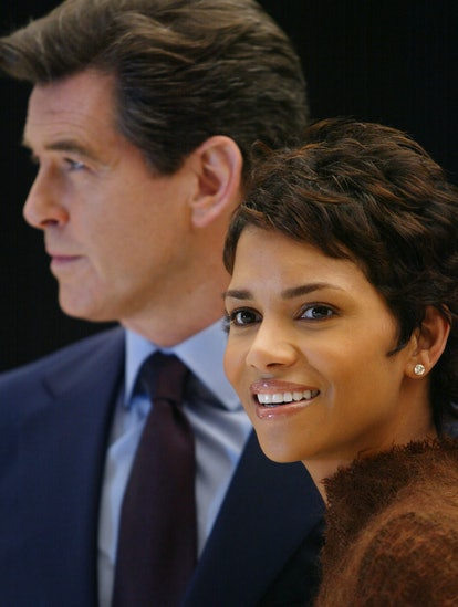 Pierce Brosnan (L) and Halle Berry (R) smile during a photocall at Pinewood Studios, 11 January 2002...