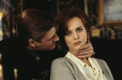 Polish actress Izabella Scorupco is menaced by English actor Sean Bean as the treacherous Alec Treve...