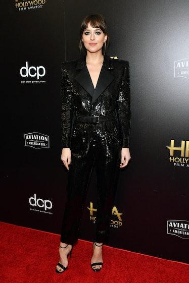BEVERLY HILLS, CALIFORNIA - NOVEMBER 03: Dakota Johnson poses in the press room during the 23rd Annu...