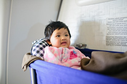 baby in airplane bassinet