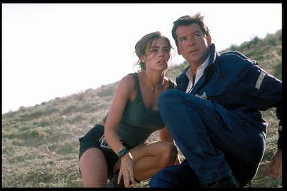 (Original Caption) Denise Richards and Pierce Brosnan on the set of the film 'The World is not Enoug...