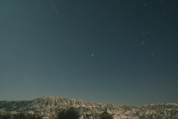 BAYINGOLIN, CHINA - JANUARY 04: A shooting star is seen at Bosten Lake scenic area as Quadrantid met...