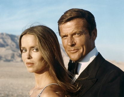 """Actor Roger Moore and actress Barbara Bach on the set of """"The Spy Who Love Me"""". (Photo by Sunset Bou..."""