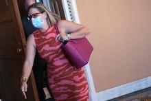 WASHINGTON, DC - SEPTEMBER 30: Sen. Kyrsten Sinema (D-AZ) leaves a Democratic luncheon before headin...