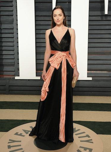 BEVERLY HILLS, CA - FEBRUARY 26:  Actress Dakota Johnson arrives at the 2017 Vanity Fair Oscar Party...