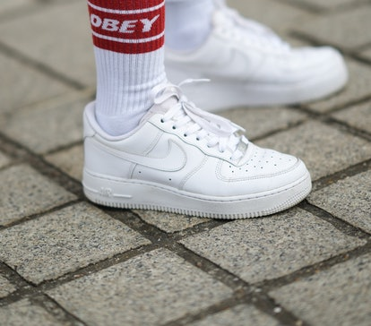 PARIS, FRANCE - JUNE 03: Patricia Contreras wears white and red Obey ankle socks, white leather Nike...