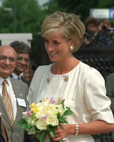 Princess Diana wearing her Cartier gold tank watch in Neasden, London.