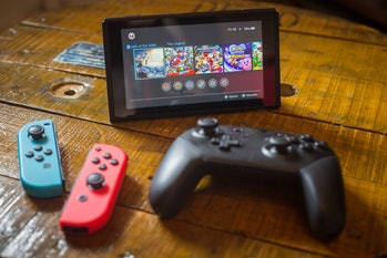 BANGKOK, THAILAND - 2018/04/27:  In this photo illustration, a turned on Nintendo Switch with 2 Joy-...
