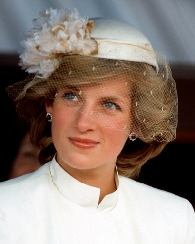 Princess Diana wears her sapphire earrings at a welcome ceremony in Tauranga, New Zealand in April 1...