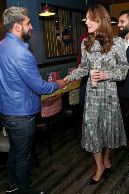 Kate Middleton meets with Amir Khan during a visit to MyLahore's flagship restaurant in Bradford, Un...
