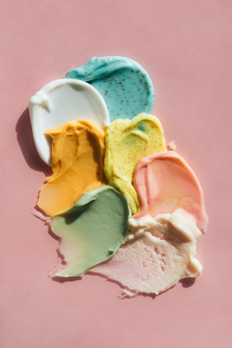 Set multicolored smears of illuminating yellow scrub with exfoliating particles and white, beige, ro...