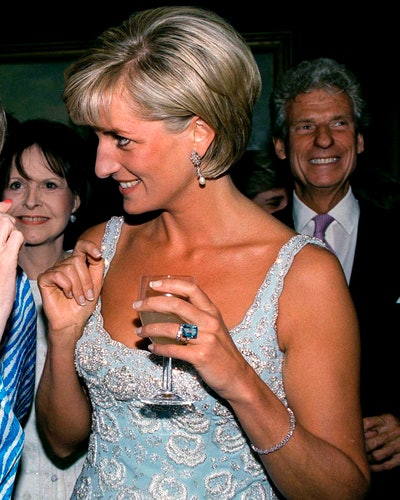 Princess Diana wears her tennis bracelet at an auction in June 1997.