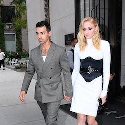 Sophie Turner wears white dress and black corset while walking in SoHo with husband Joe Jonas on Aug...