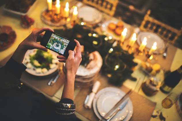 Showing off your table setting is one idea for Thanksgiving family pictures.