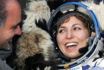 Arkalyk, KAZAKHSTAN:  The world's first female space tourist Anousheh Ansari looks at her husband Ha...