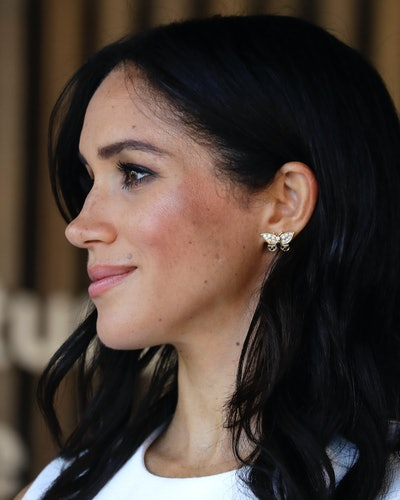 Meghan Markle wearing Princess Diana's butterfly earrings on her first royal tour in October 2018.
