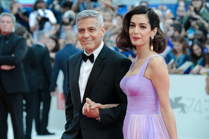 American actor George Clooney with his wife Amal Clooney during the Suburbicon premiere on the occas...