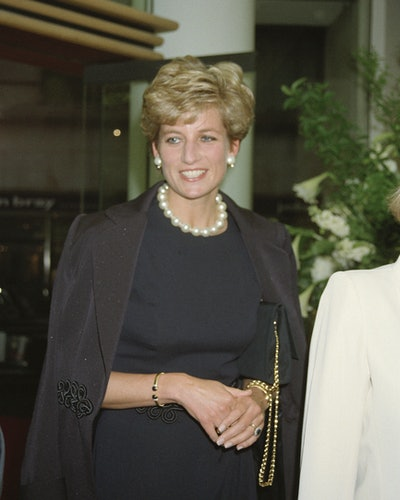 Princess Diana wearing her gold and blue stone cuff in Mayfair in May 1994.