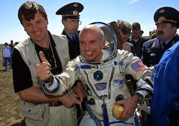 US space tourist Dennis Tito celebrates after his landing near the Kazakh town of Arkalyk (some 300 ...