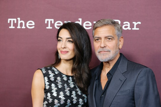 LOS ANGELES, CALIFORNIA - OCTOBER 03: Amal Clooney (L) and George Clooney (R) attend the Los Angeles...
