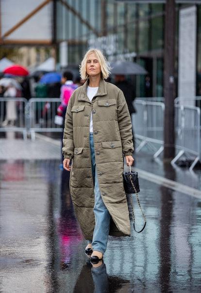 PARIS, FRANCE - OCTOBER 05: Linda Tol seen wearing bag, olive coat, denim jeans outside Chanel durin...