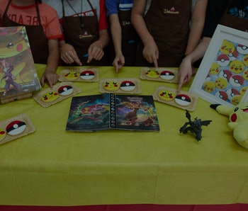 MADRID, SPAIN - AUGUST 16: Several children show the Pokemon cookies they have made at a summer camp...