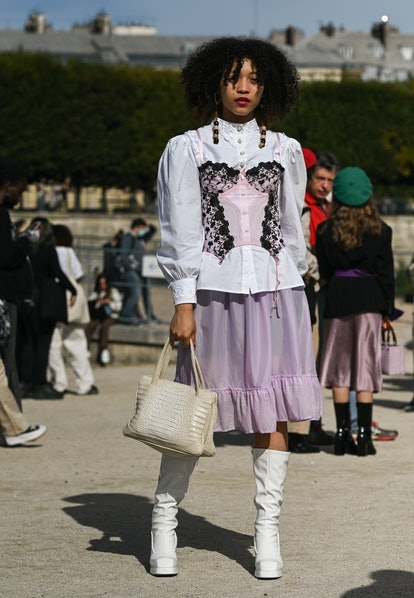 PARIS, FRANCE - SEPTEMBER 28: A guest is seen wearing a white blouse, pink corset, pink skirt, white...