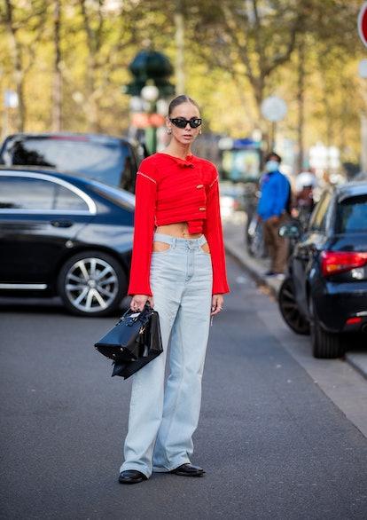 PARIS, FRANCE - SEPTEMBER 28: Hilda Sandström is seen wearing red top, denim jeans, black bag outsid...