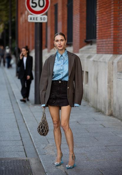 PARIS, FRANCE - SEPTEMBER 29: Pernille Teisbaek seen wearing skirt, blazer, denim button shirt outsi...