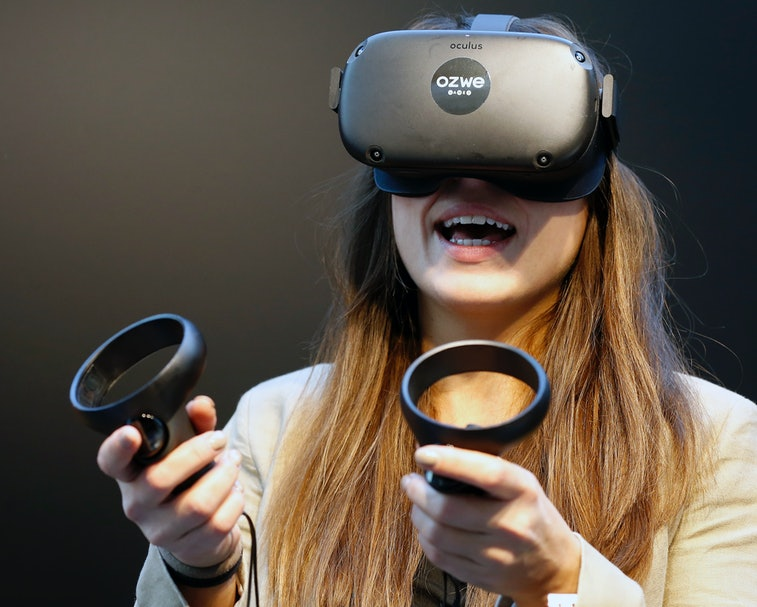 PARIS, FRANCE - NOVEMBER 21: A visitor tries a virtual reality helmet Oculus Quest during the Virtua...