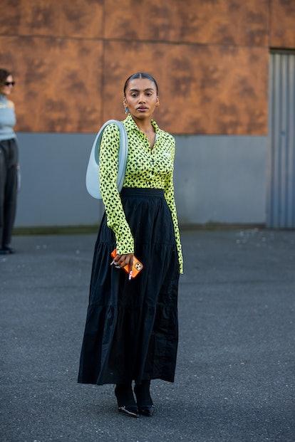 PARIS, FRANCE - SEPTEMBER 30: Marie-Victoire Tiangue seen  wearing black skirt, yellow button shirt ...