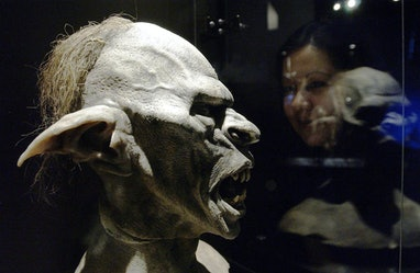 A visitor examines a model of an orc during a photocall for the launch of The Lord Of The Rings: The...