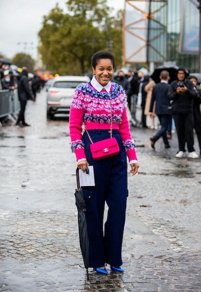 PARIS, FRANCE - OCTOBER 05: Tamu McPherson seen wearing Chanel bag, jumper, navy pants outside Chane...