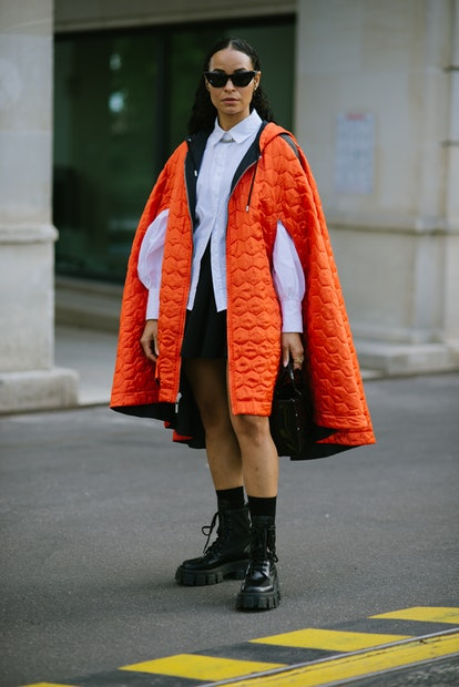 PARIS, FRANCE - SEPTEMBER 28: A guest poses wearing a Koche coat after the Koche show at the Shangri...