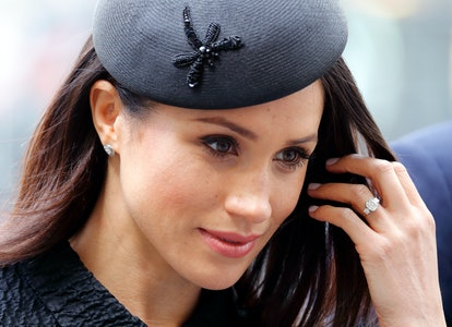 Meghan Markle wearing Princess Diana's diamonds in her engagement ring.
