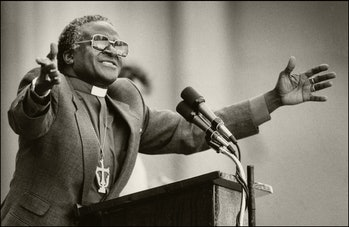 South African religious leader and activist Bishop Desmond Tutu  gestures as he gives a speech at th...