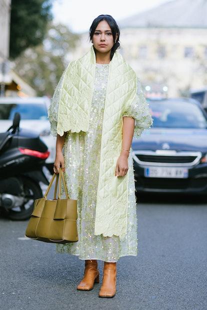 PARIS, FRANCE - SEPTEMBER 29: A guest poses wearing Cecilie Bahnsen after the Cecilie Bahnsen presen...
