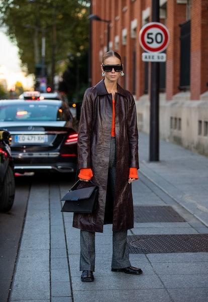 PARIS, FRANCE - SEPTEMBER 29: Hilda Sandström seen wearing brown coat outside Acne during Paris Fash...