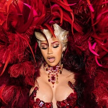 Cardi B's Paris Fashion Week 2021 looks made her the MVP at the front row. From feathers to breastpl...