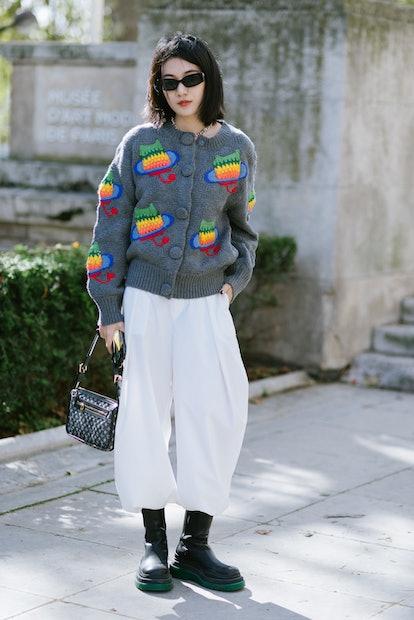 PARIS, FRANCE - OCTOBER 04: Yishan Li poses wearing a Uooya jumper after the Giambattista Valli show...