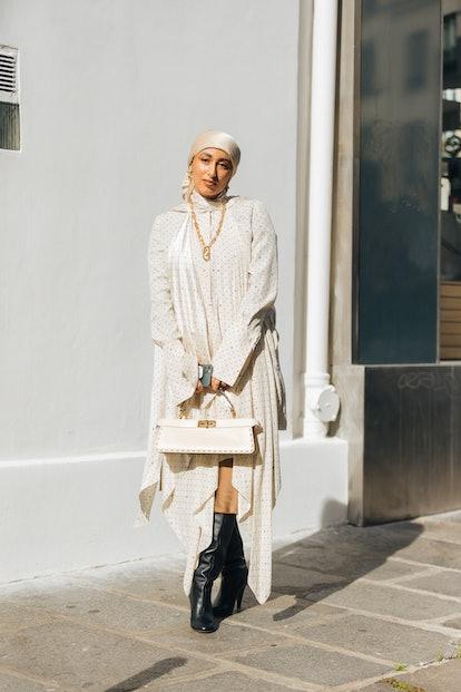 PARIS, FRANCE - OCTOBER 02: Hijabi influencer Taqwa Bintali wears an all white Fendi outfit - Fendi ...