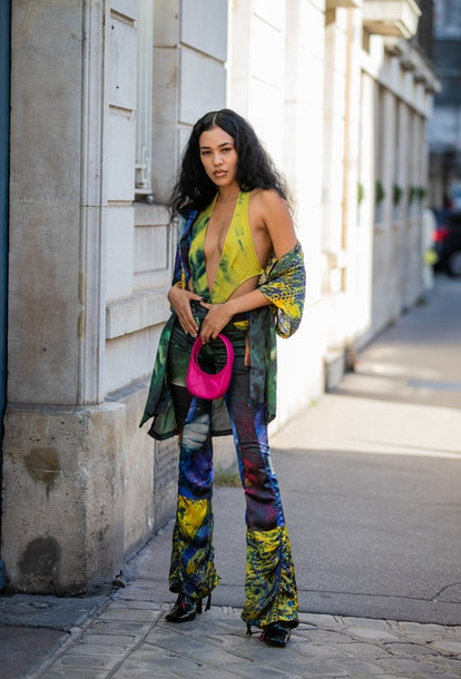 PARIS, FRANCE - SEPTEMBER 28: Aleali Mayis seen wearing top, jacket and flared sheer pants with colo...