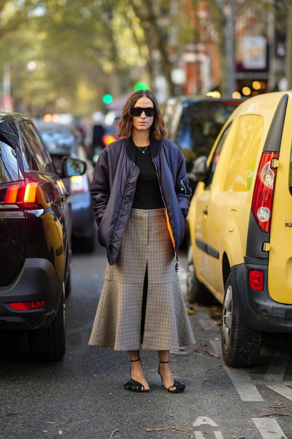 PARIS, FRANCE - OCTOBER 04: Erika Boldrin wears black sunglasses, a silver chain pendant necklace, a...