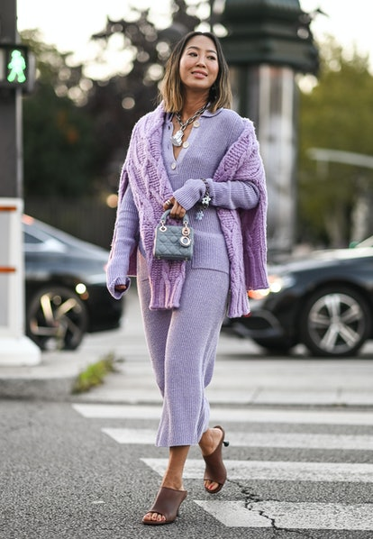 PARIS, FRANCE - SEPTEMBER 29:  Aimee Song is seen wearing a purple Acne outfit outside the Acne show...