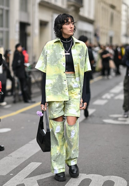 PARIS, FRANCE - OCTOBER 02: A guest is seen wearing a green tie dye top and pants outside the Vivien...
