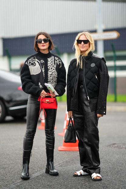 PARIS, FRANCE - OCTOBER 02: (L-R) Alexandra Pereira wears black sunglasses, a black with white embro...